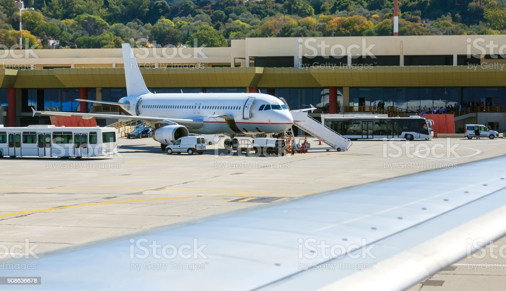 aircraft maintenance before taking off on background of the airport building. Rhodes, Greece, Diagoras stock photo