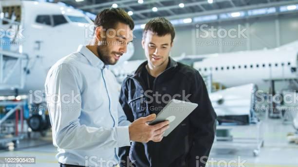 Aircraft maintenance worker and engineer having conversation holding picture id1022905428?b=1&k=6&m=1022905428&s=612x612&h=ensr43mu kfjsqcjm9kq2kci12xkgvpgbydk3  zzjq=