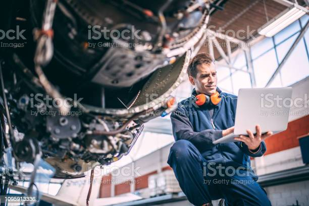 Aircraft mechanic doing some diagnostics on a laptop next to a jet picture id1095913336?b=1&k=6&m=1095913336&s=612x612&h=gxp81zi7wx29frmgfzo s3zag7zhrswhosdu1bel2 0=