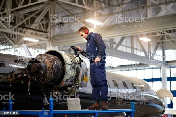 Aircraft mechanic in the hangar picture id909516896?b=1&k=6&m=909516896&s=612x612&h=nurwk4wdw5sgo8aqjkr rafx9twyc4 pmrjdge6tpxu=