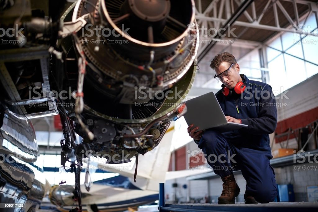 Aircraft mechanic in the hangar stock photo
