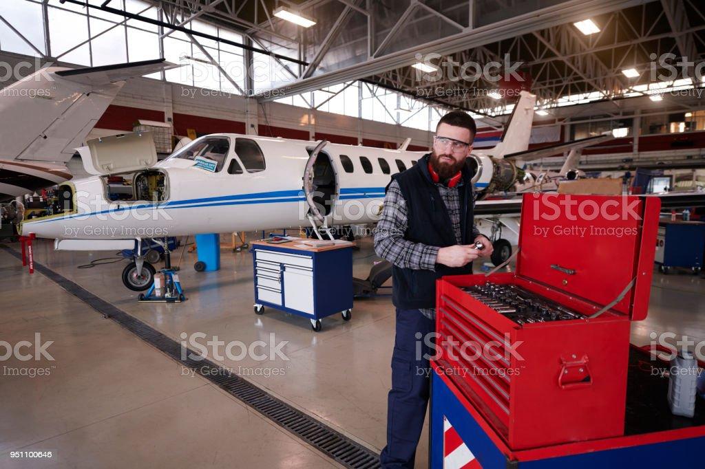 Aircraft mechanic in the hangar stock photo