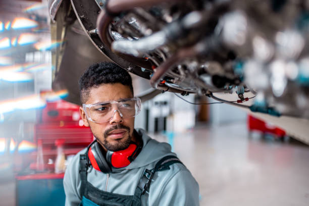 Aircraft mechanic inspects the jet engine stock photo