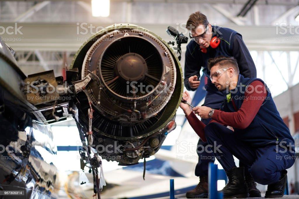 Aircraft mechanics in the hangar stock photo