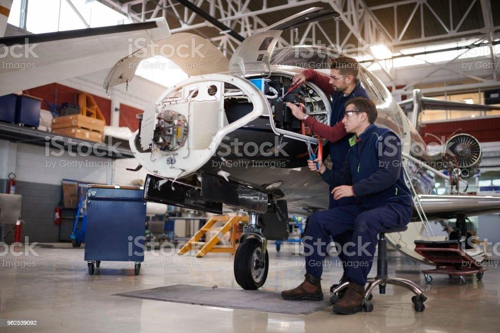 Aircraft mechanics in the hangar - Royalty-free Adult Stock Photo