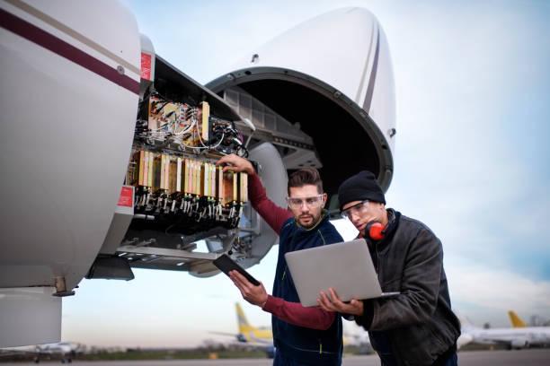 Aircraft mechanics stock photo
