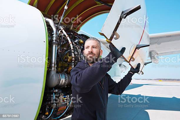 Aircraft Mechnic In Front Of Aircraft Engine Stock Photo - Download Image Now