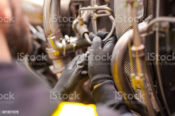 Aircraft Mechnic Repairing Jet Engine Stock Photo - Download Image Now