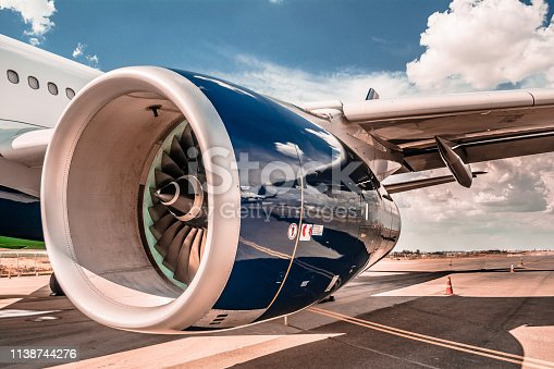 istock Aircraft number one Engine-left side-No say turbine, the correct is engine. 1138744276