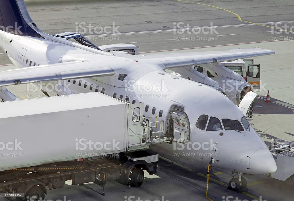 Aircraft on airfield prepairing for the flight royalty-free stock photo
