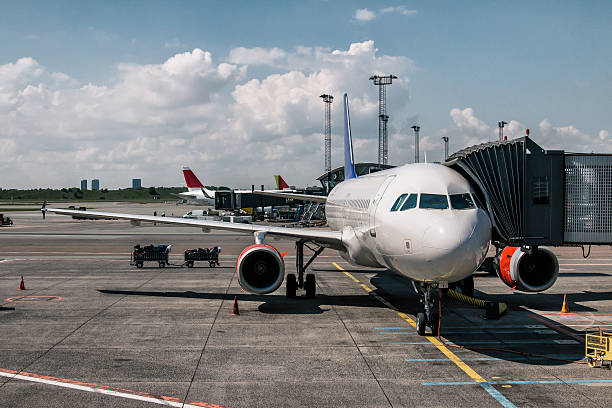 Aircraft parked at the gate stock photo