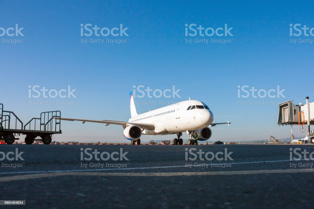 Aircraft preparing to take ground handling on the airport apron stock photo