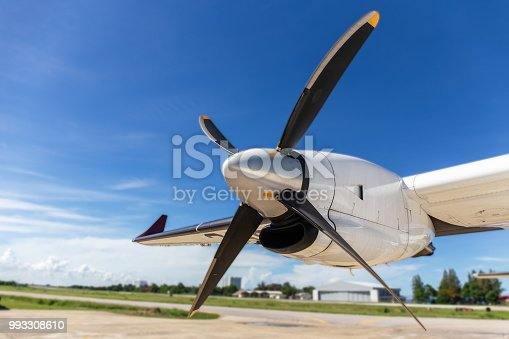 istock aircraft propeller blade and turboprop engines with airfield and blue sky background 993308610