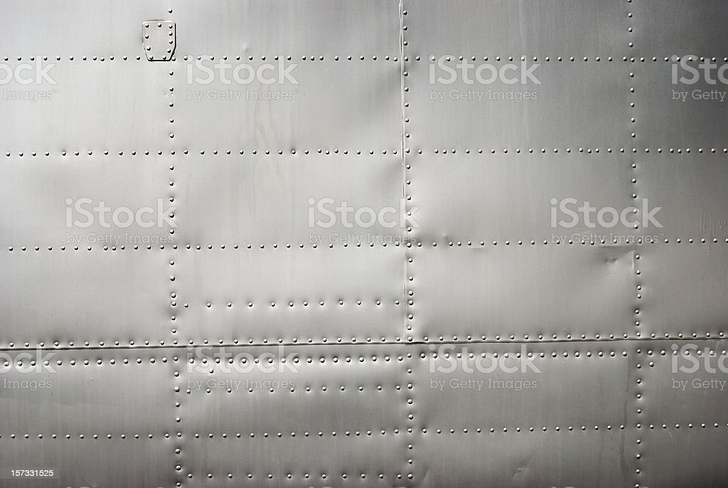 Aircraft siding background with rivets and soft shadows royalty-free stock photo
