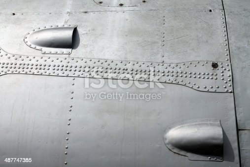 Rivets on fuselage of an old airplane.