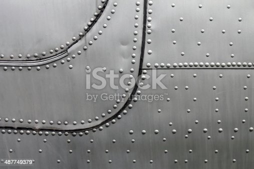 istock Aircraft siding with rivets 487749379