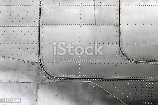 istock Aircraft siding with rivets 487808089