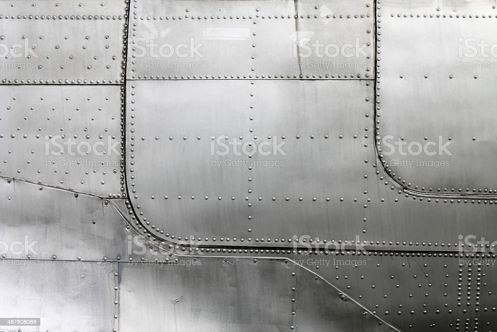 Aircraft siding with rivets stock photo