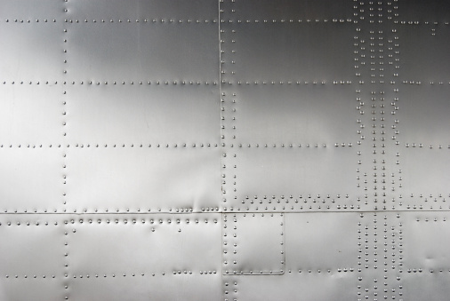 Aircraft siding with rivets, textured background