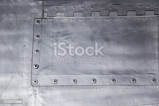487808089 istock photo Aircraft skin close up. Rivets on gray metal. 1210342989