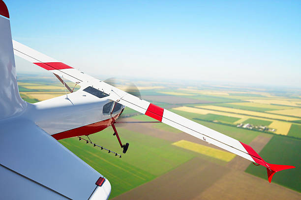 Aircraft spraying in the fields stock photo
