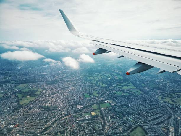 Aircraft view from the window of cabin passenger on the air with land below of United Kingdom London City stock photo