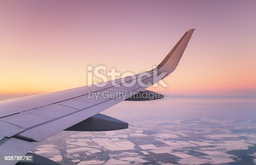 istock Aircraft wind on the sunrise sky background. Composition of aircraft 938785792