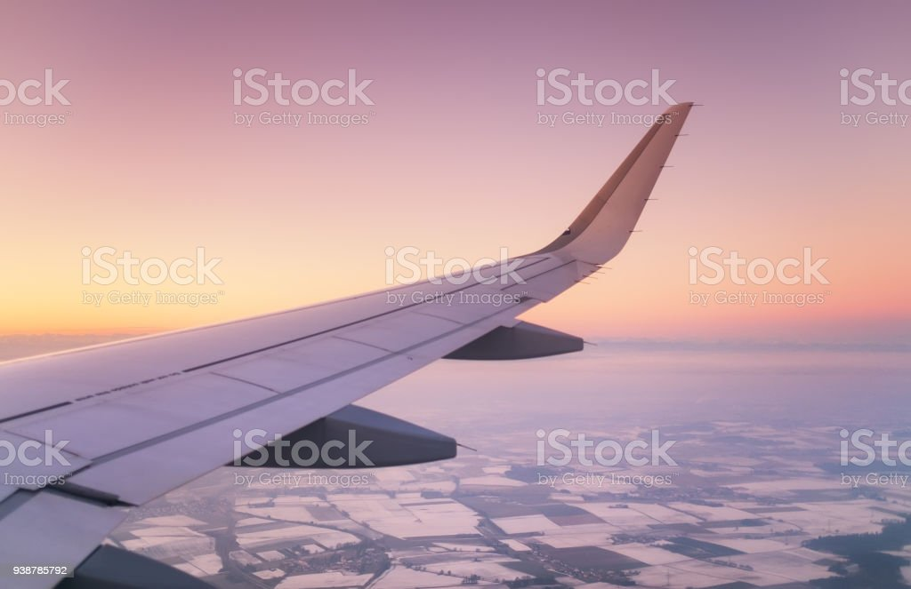 Aircraft wind on the sunrise sky background. Composition of aircraft stock photo