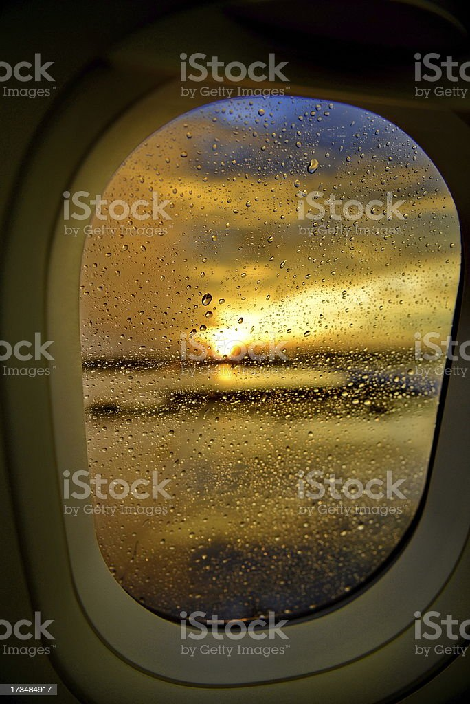 aircraft window with rain drop and sunset royalty-free stock photo