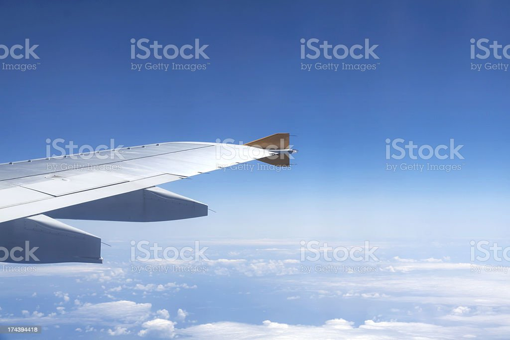 Aircraft Wing Above The Clouds stock photo
