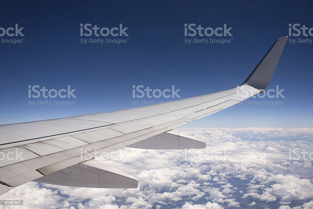 Aircraft wing on blue sky royalty-free stock photo