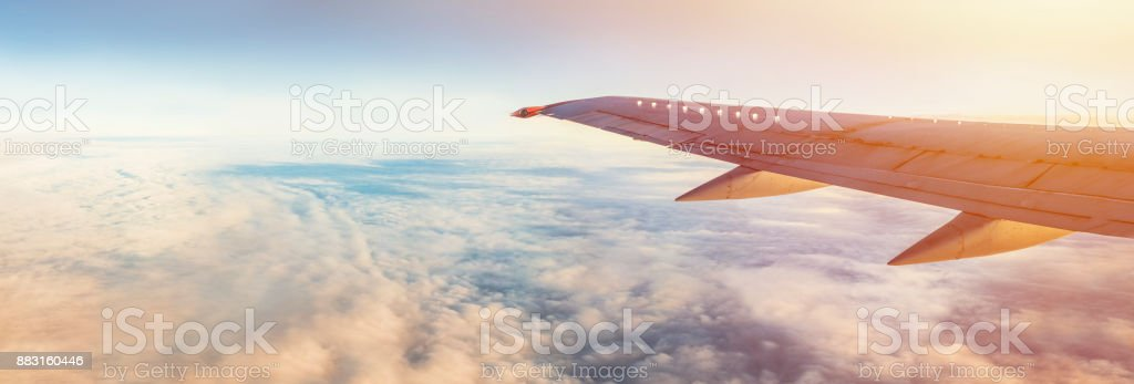 Aircraft wing under the earth and clouds. Flight in sky. stock photo