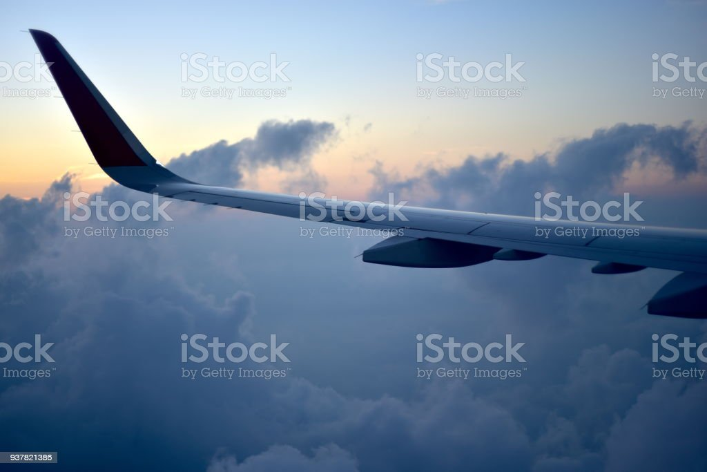 Aircraft wing with morning sky background photo stock photo