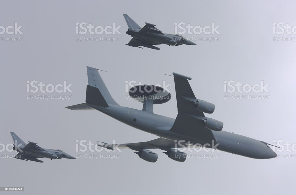 AWACS aircraft with Eurofighter escorts royalty-free stock photo