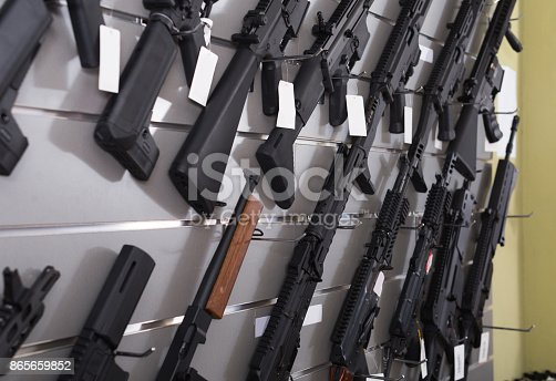 istock air-driven rifle   hangs on the wall in  army store 865659852