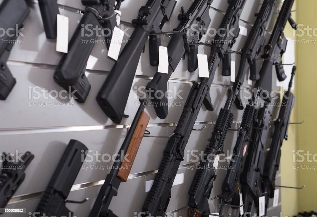 air-driven rifle   hangs on the wall in  army store stock photo