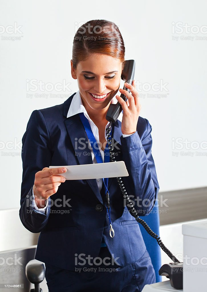 Airline check in attendant at work royalty-free stock photo