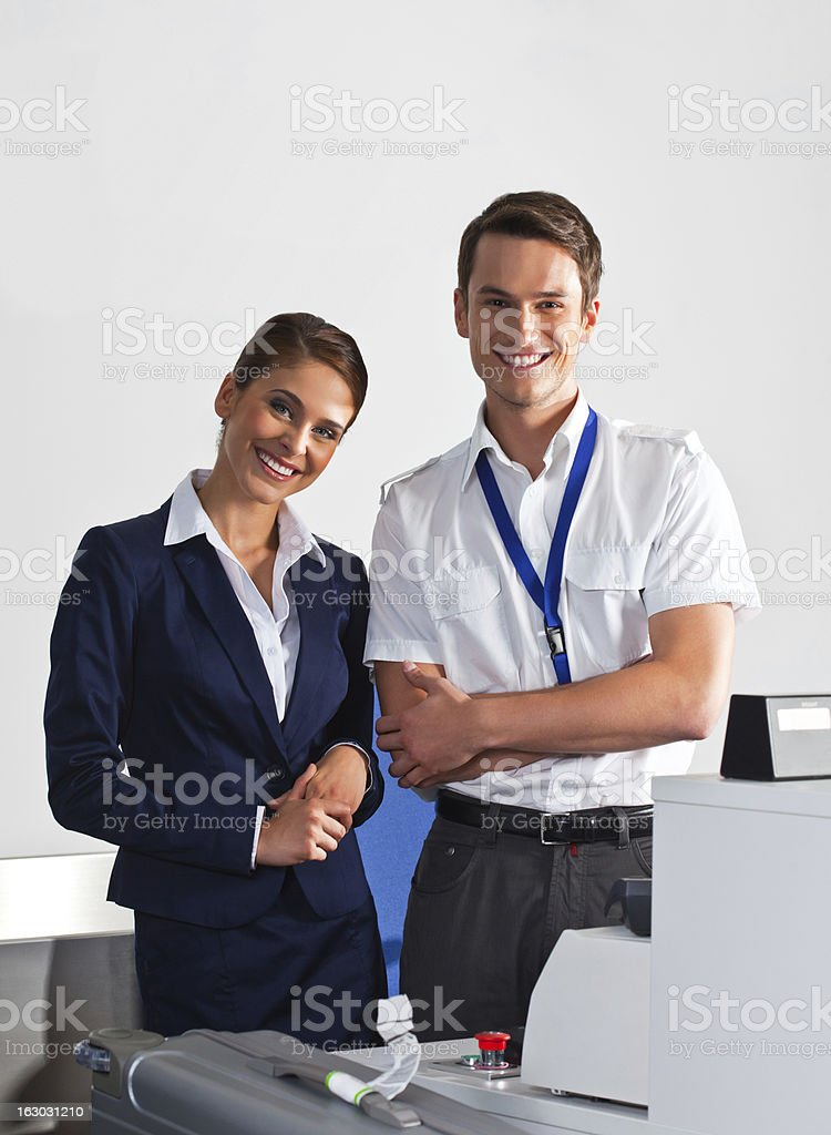 Airline check in attendants at work stock photo