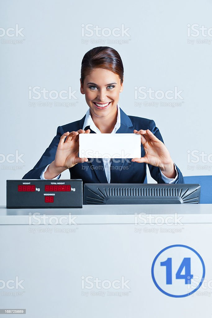 Airline check in attendants showing ticket royalty-free stock photo