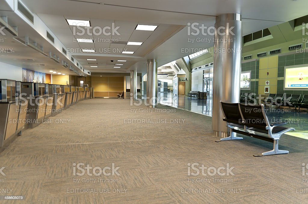 Airline Check In Counter and Concourse with No Travelers stock photo