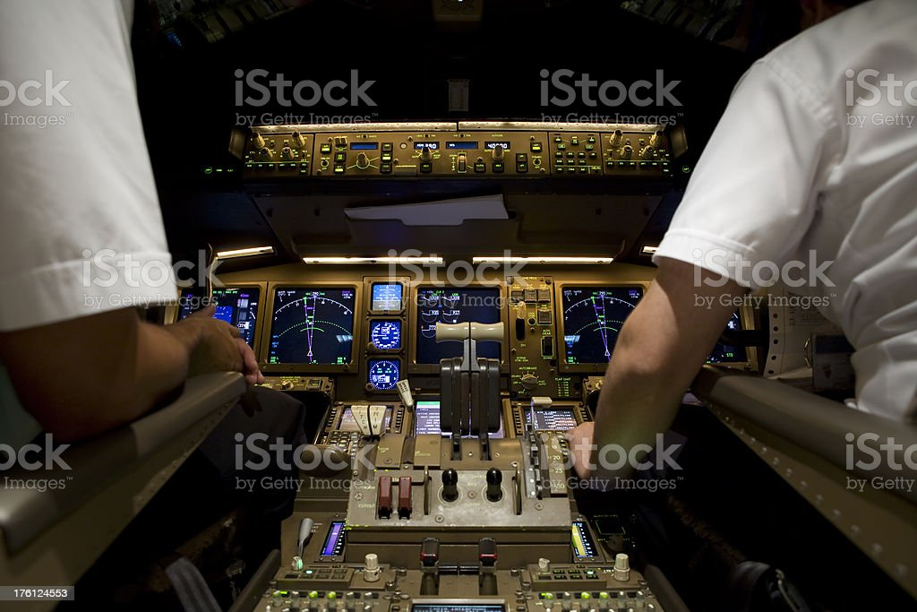 Airline Cockpit at Night stock photo