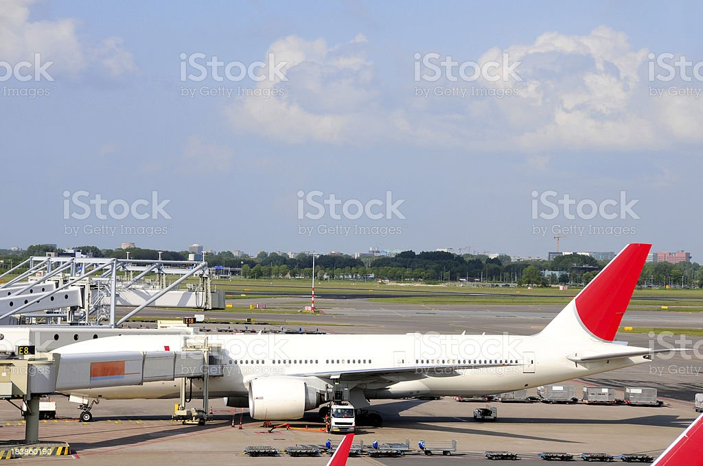 An airplane at Schiphol airport in the Netherlands. The passengers...