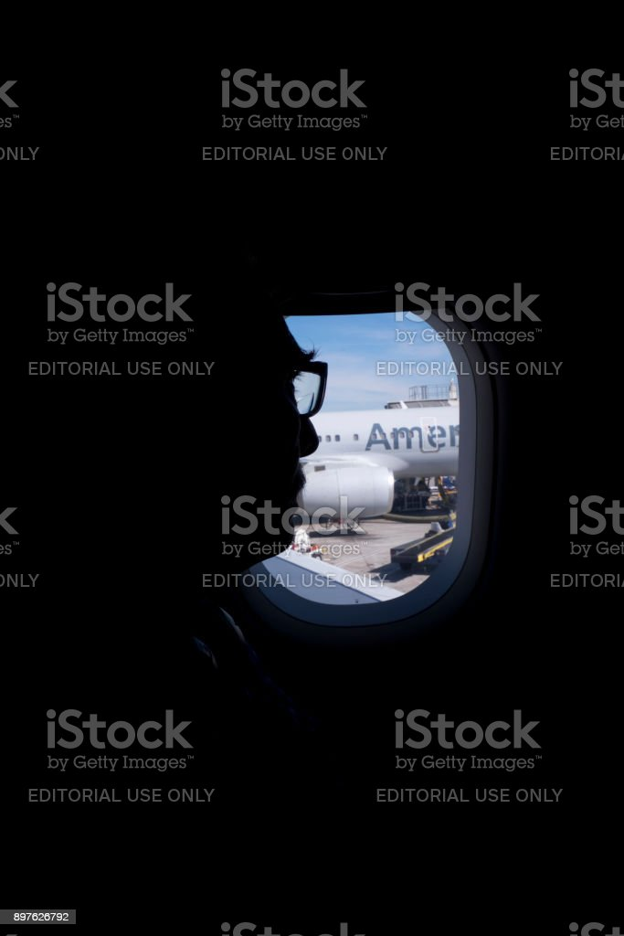 Airline Passenger Looking Out Window stock photo