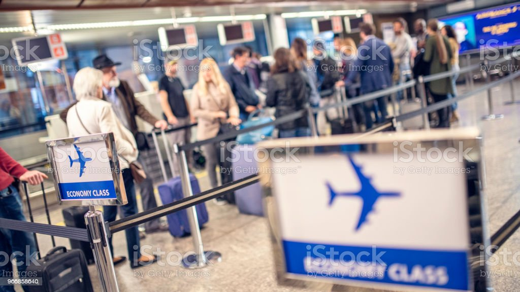 Airline passengers waiting in line stock photo