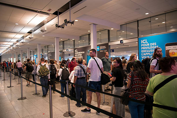 Airline passengers waiting in line to pass through airport security stock photo