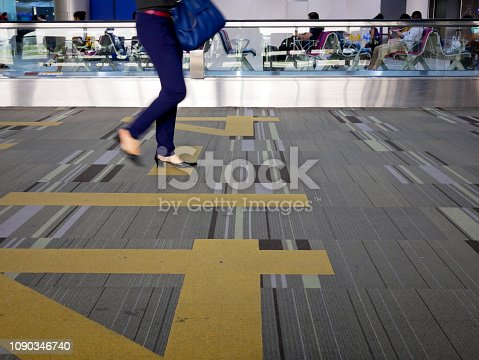 istock Airline passengers walking in the airport terminal 1090346740