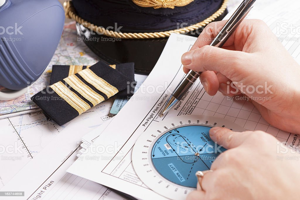 Airline pilot filling in the flight plan before take-off royalty-free stock photo
