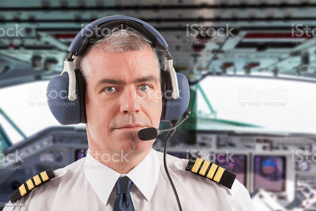 Airline pilot on board stock photo