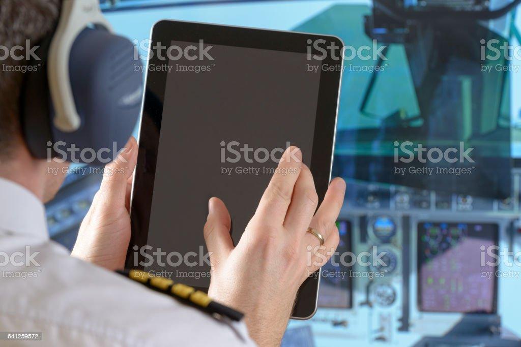 Airline pilot using smart phone stock photo