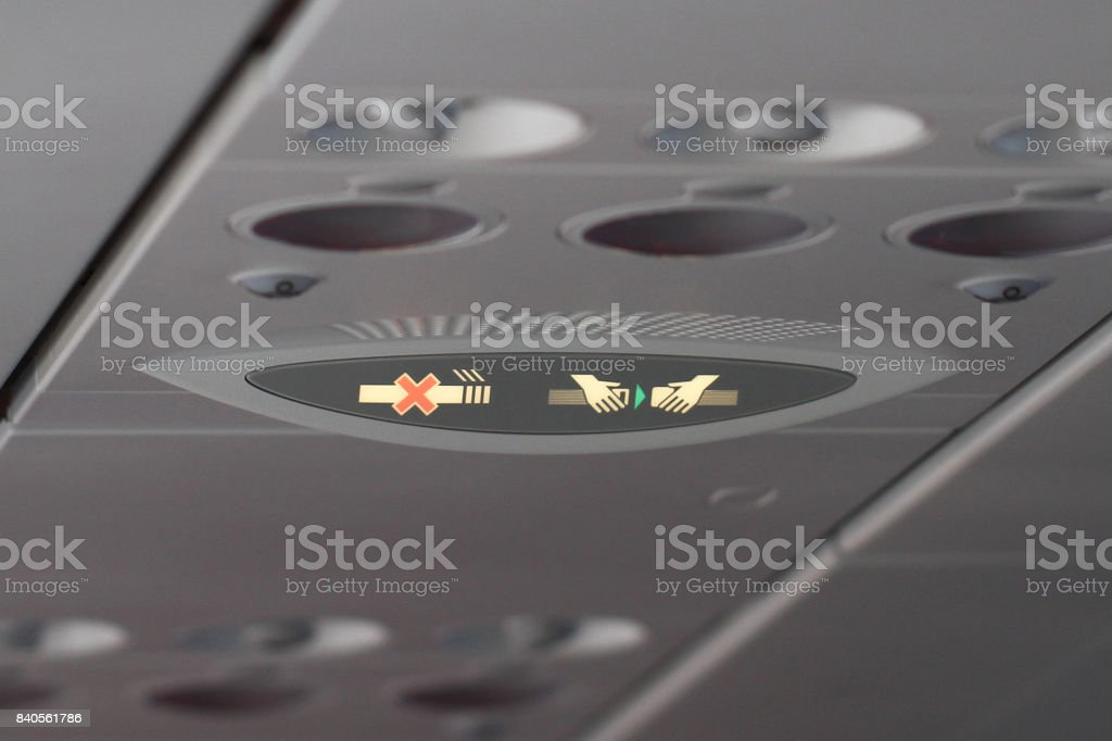 airline safety demonstration, light symbol on aircraft, seat belt and non smoking sign, flight Attendant stock photo